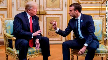 US President Donald Trump (L) speaks s with French president Emmanuel Macron prior to their meeting at the Elysee Palace in Paris, on November 10, 2018, on the sidelines of commemorations marking the 100th anniversary of the 11 November 1918 armistice, ending World War I. (Photo by Christophe Petit-Tesson / POOL / AFP)        (Photo credit should read CHRISTOPHE PETIT-TESSON/AFP/Getty Images)