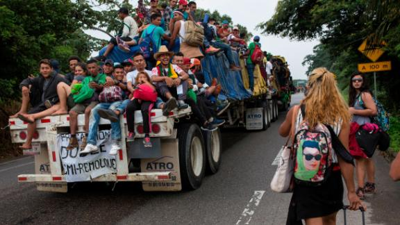 In this November 2, 2018 photo, Central American migrants who hitched a ride on a flatbed truck jeer at LGBT migrants on the road to Donaji, Mexico. For the dozens of transgender women and gay men, the journey has meant putting up with insulting catcalls and even some physical abuse.