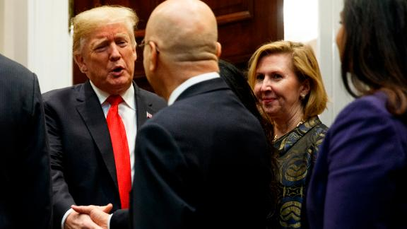 """Deputy National Security Adviser Mira Ricardel, right, watches as President Donald Trump arrives for a Diwali ceremonial lighting of the Diya in the Roosevelt Room of the White House, Tuesday, Nov. 13, 2018, in Washington. In an extraordinary move, first lady Melania Trump is publicly calling for the dismissal of Ricardel. After reports circulated that the president had decided to remove Ricardel, the first lady's spokeswoman issued a statement saying: """"It is the position of the Office of the First Lady that she no longer deserves the honor of serving in this White House."""" Ricardel is national security adviser John Bolton's deputy."""
