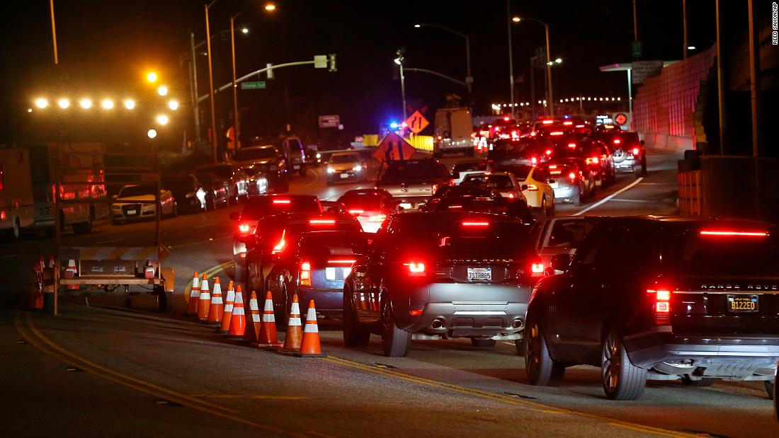 A long line of residents seeking to return to Malibu wait at a checkpoint on Pacific Coast Highway after Woolsey Fire evacuation orders were lifted for the eastern portion of the city on November 13.