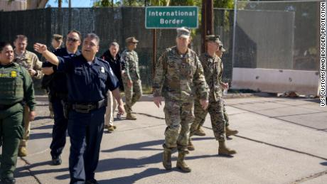 Calexico Port Director David Salazar guides US Army North Commander Lt. Gen. Jeffrey Buchanan on a tour of the Calexico West Port of Entry.  They are accompanied by Chief Patrol Agent of the US Border Patrol El Centro Sector Gloria Chavez and San Diego Director of Field Operations Pete Flores. November 13, 2018.  Photo by Ralph Desio.