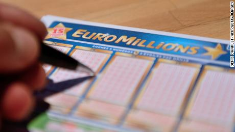 The search for the winner of the $97.5 million EuroMillions jackpot intensified after lottery organizers published the location where the winning ticket was bought.