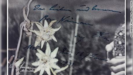 "A close-up shot of Hitler's handwritten message on the photograph, translated by the auction house as saying ""The dear and (considerate?) Rosa Nienau Adolf Hitler Munich, the 16th June 1933."""