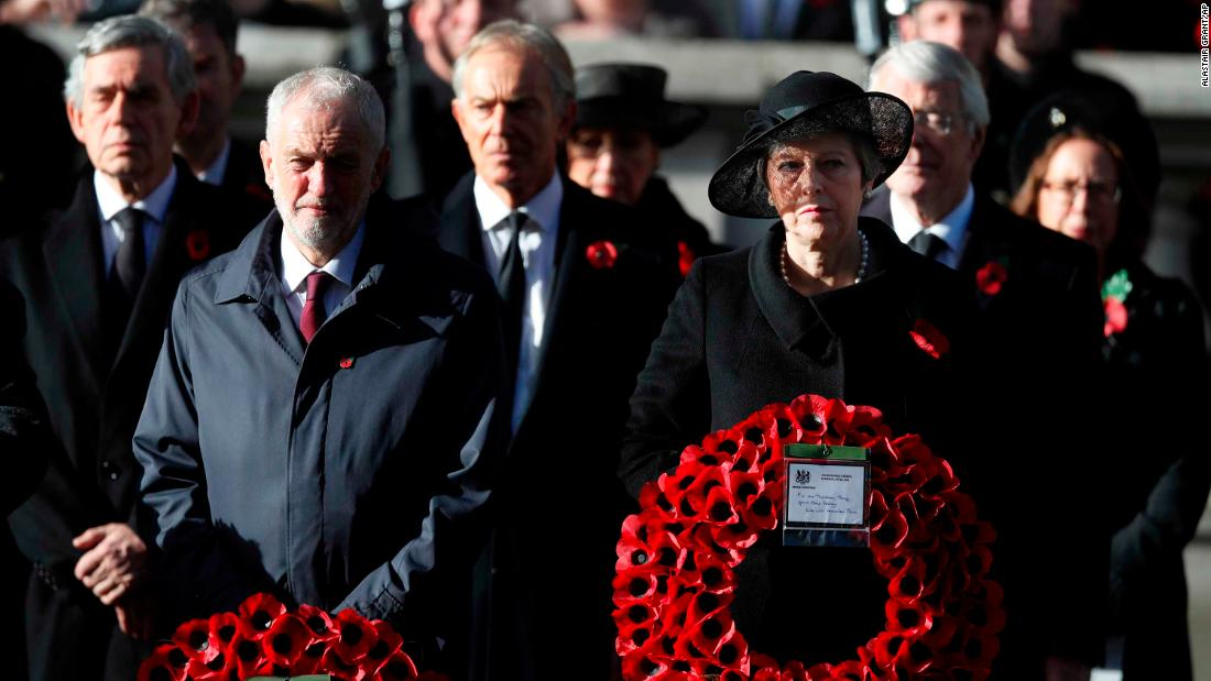 May stands next to Labour Party leader Jeremy Corbyn at a Remembrance Day ceremony in London in November 2018. Behind them, from left, are former Prime Ministers Gordon Brown and Tony Blair.