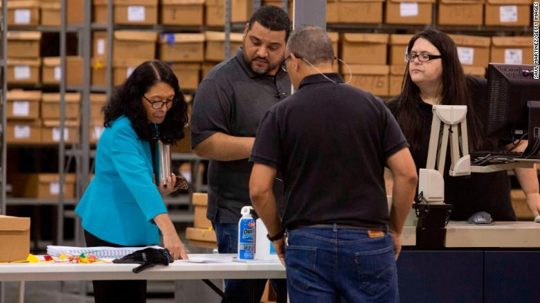 PALM BEACH, FL - NOVEMBER 15: Palm Beach County Supervisor of Elections Susan Bucher (L) supervises workers that are preparing to feed ballots through machines at the Supervisor of Elections Service Center on November 15, 2018 in Palm Beach, Florida. After ballot-counting machines overheated in Palm Beach County on Tuesday forcing a restart of vote counting, the county continued to count votes but missed the Thursday 3pm deadline. (Photo by Saul Martinez/Getty Images)