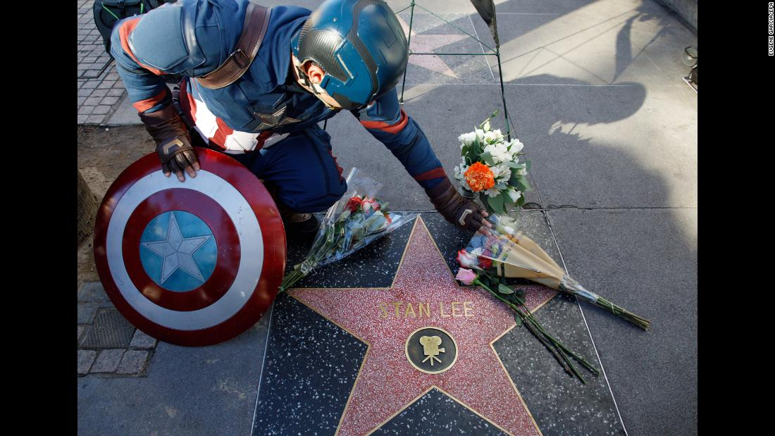 "A man wearing a Captain America costume visits Stan Lee's star on the Hollywood Walk of Fame on Monday, November 12. Lee, the colorful Marvel Comics patriarch who helped usher in a new era of superhero storytelling and saw his creations become a giant influence in the movie business, <a href=""https://www.cnn.com/2018/11/12/entertainment/stan-lee-obit/index.html"" target=""_blank"">died Monday</a> at the age of 95. <a href=""http://www.cnn.com/2018/11/12/entertainment/gallery/stan-lee/index.html"" target=""_blank"">See Stan Lee's life in pictures</a>"