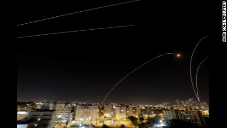 A general view of the Israeli city of Ashkelon, as an Iron Dome anti-missile fires near the Israeli side of the Israel-Gaza border, November 12, 2018 .