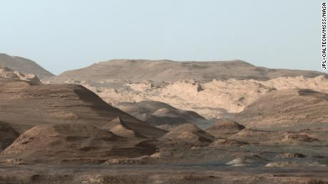 This composite image looking toward the higher regions of Mount Sharp was taken on September 9, 2015, by NASA's Curiosity rover. In the foreground -- about 2 miles (3 kilometers) from the rover -- is a long ridge teeming with hematite, an iron oxide. Just beyond is an undulating plain rich in clay minerals. And just beyond that are a multitude of rounded buttes, all high in sulfate minerals. The changing mineralogy in these layers of Mount Sharp suggests a changing environment in early Mars, though all involve exposure to water billions of years ago. The Curiosity team hopes to be able to explore these diverse areas in the months and years ahead. Further back in the image are striking, light-toned cliffs in rock that may have formed in drier times and now is heavily eroded by winds.