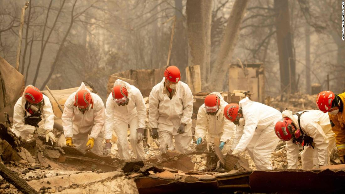 Rescue workers sift through rubble in search of human remains on Wednesday, November 14, at a burned property in Paradise.
