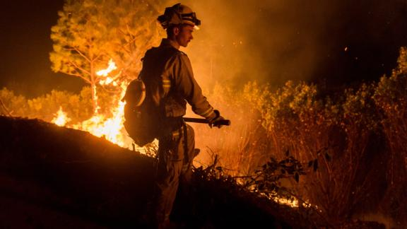 Firefighters work to control the Camp Fire on November 14 north of Oroville, California.