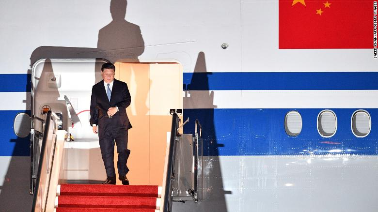 China's President Xi Jinping walks down the stairs of his plane upon arrival at Port Moresby International Airport on November 15.
