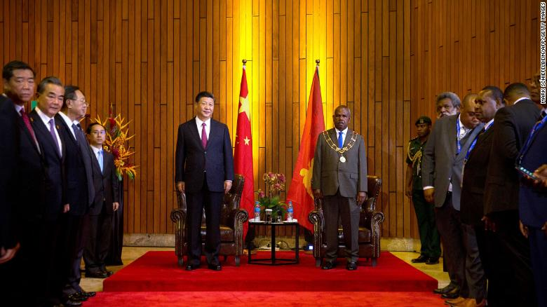 China's President Xi and Papua New Guinea's Governor General Bob Dadae stand before a meeting at Parliament House in Port Moresby on November 16.