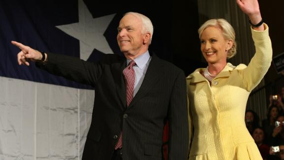 Republican presidential candidate US Senator John McCain (R-AZ) and his wife Cindy wave to supporters after securing the GOP nomination on March 4, 2008 in Dallas, Texas.  McCain seized the Republicans