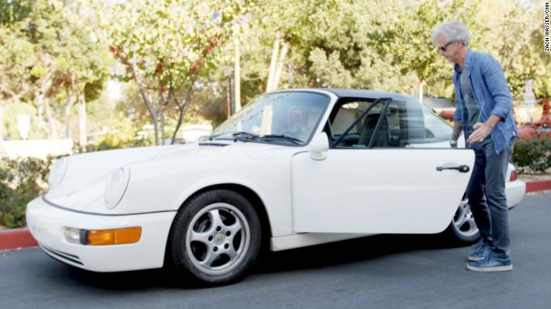 John Krafcik getting into his Porsche 911.