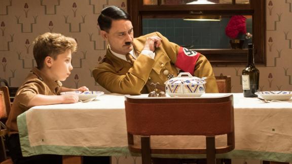 "Upcoming film ""Jojo Rabbit"" features Roman Griffin Davis as Jojo, Scarlett Johansson as his mother Rosie and writer/director Taika Waititi as his imaginary friend Adolf."