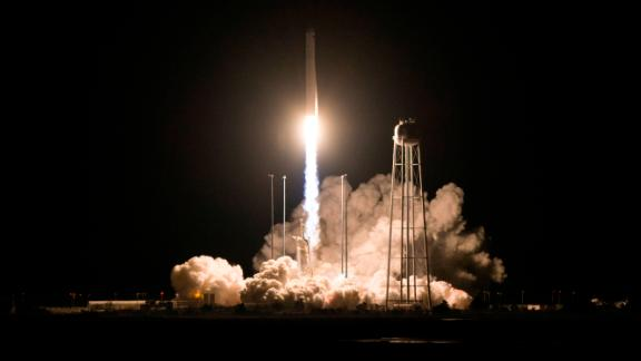 In this photo released by NASA, the Northrop Grumman Antares rocket, with Cygnus resupply spacecraft onboard, launches from Pad-0A, Saturday, Nov. 17, 2018 at NASA's Wallops Flight Facility in Va. (Joel Kowsky/NASA via AP)