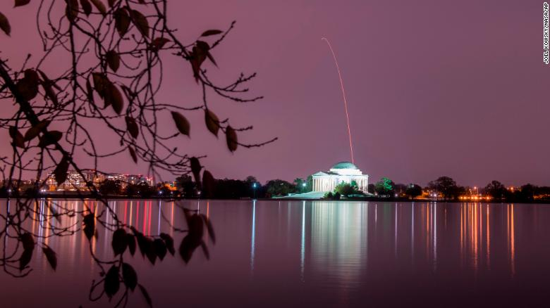 The Northrop Grumman Antares rocket is seen on November 17 above the Thomas Jefferson Memorial as it launches, this long-exposure photo released by NASA shows.