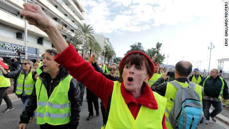 Protesters wearing yellow vests demonstrate on the Promenade des Anglais in Nice, southern France, on Saturday.