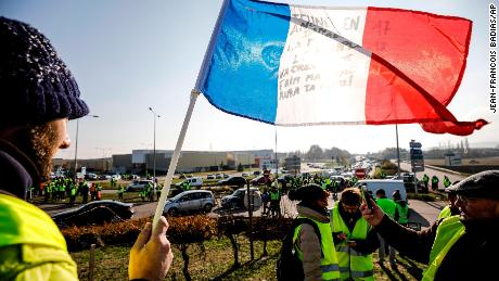 Demonstrators block a roundabout in Molsheim, eastern France, on Saturday in the protest over rising fuel taxes.