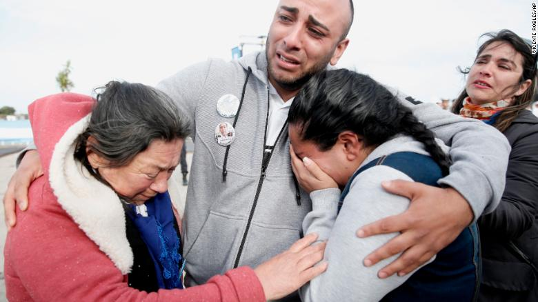 Relatives of the missing crew embrace Thursday, November 15, 2018, after a ceremony marking the anniversary of the ARA San Juan's disappearance at a navy base in Mar del Plata, Argentina.