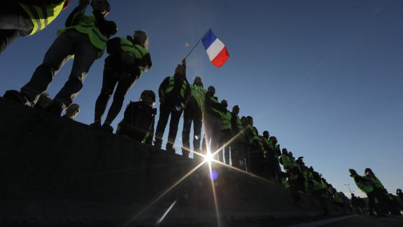 People wearing yellow vests block the motorway in Antibes, southeastern France, on Saturday.