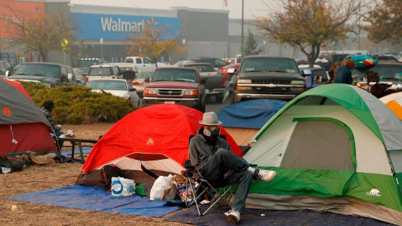 People displaced by the Camp Fire have set up tents outside a Walmart store.