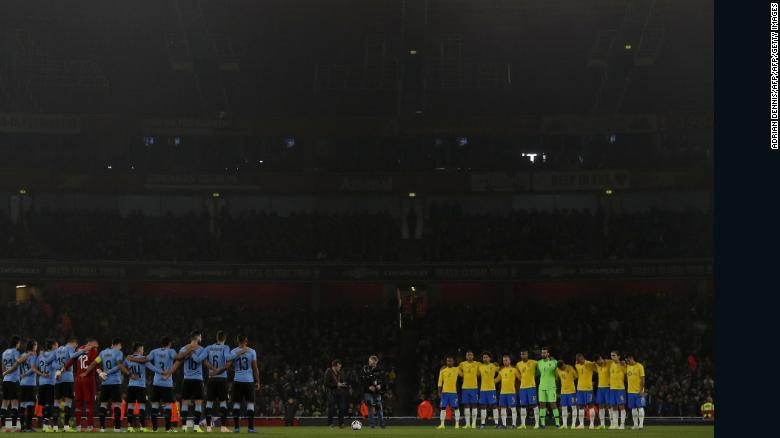 Uruguay and Brazil players honor Schlee with a minute's silence ahead of an international friendly in London on Friday.