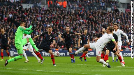England's Harry Kane provides an assist for Jesse Lingard for the team's first goal against Croatia.