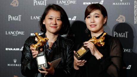 "Taiwanese director Fu Yue (right) poses backstage after winning Best Documentary for her movie ""Our Youth in Taiwan"" at the 55th Golden Horse Awards in Taipei on November 17, 2018."