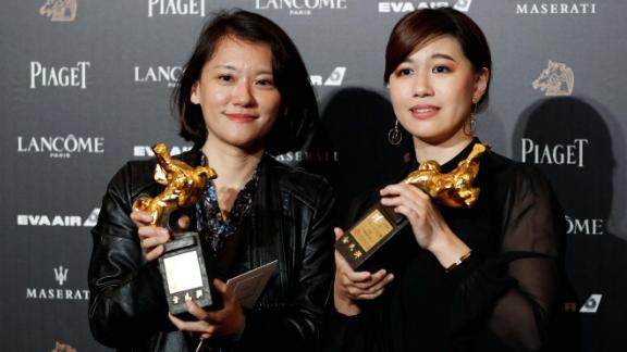 "Taiwanese director Fu Yue (R) poses backstage after winning Best Documentary for her movie ""Our Youth in Taiwan"" at the 55th Golden Horse Awards in Taipei on November 17, 2018."