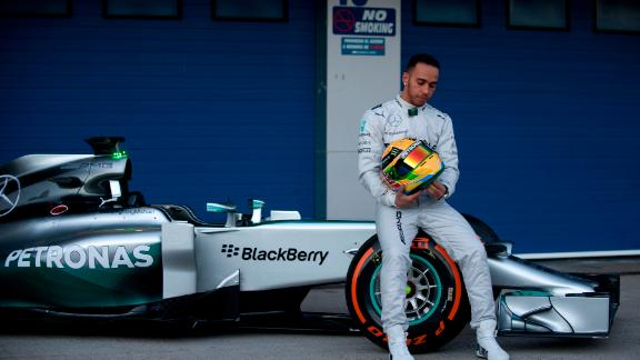 Five-time F1 champion Lewis Hamilton poses at the unveiling of the Mercedes W05.