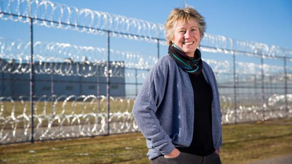 Ellen Stackable, co-founder of the nonprofit Poetic Justice, teaches female prisoners in Oklahoma self-expression through creative writing. Stackable is pictured here outside of the Mabel Bassett Correctional Center in McLoud, Oklahoma.