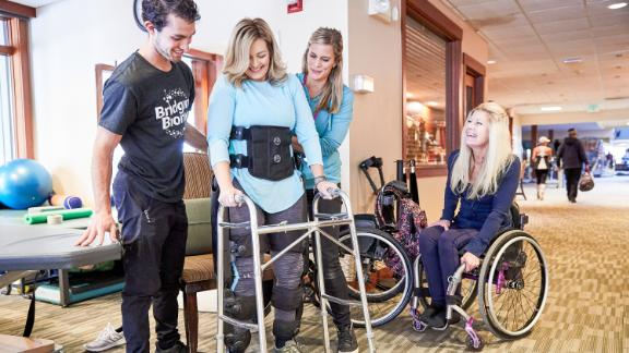 "Boxtel survived a horrific skiing accident, and doctors told her she would never walk again. She defied those expectations with the help of machines called bionic exoskeleton suits, which inspired Boxtel to create Bridging Bionics. ""People need to start believing in themselves and their potential. Life isn"