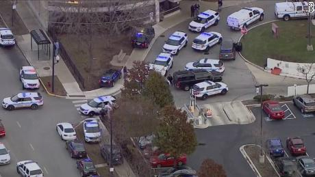 Police say the shooting began in a parking lot.