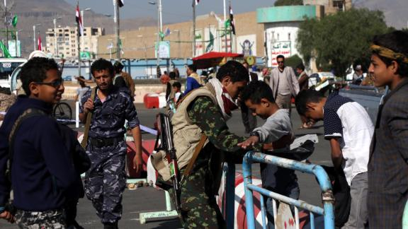 Houthi fighters check people entering a square for a rally last month in Sanaa.