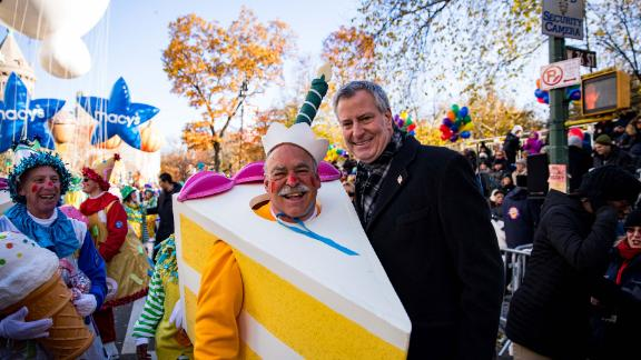 Bankruptcy lawyer Chuck Tatelbaum, seen here with New York City Mayor Bill de Blasio, has walked in the Macy