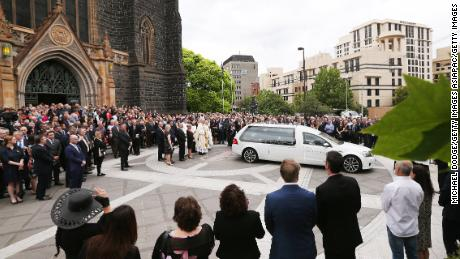The hearse carrying the body of Sisto Malaspina leaves during the state funeral for Sisto Malaspina at St. Patrick's Cathedral on Tuesday in Melbourne.