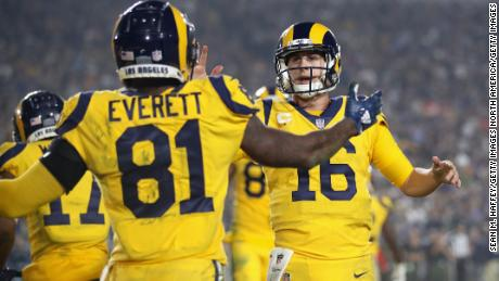 Quarterback Jared Goff #16 of the Los Angeles Rams celebrates with teammate Gerald Everett.