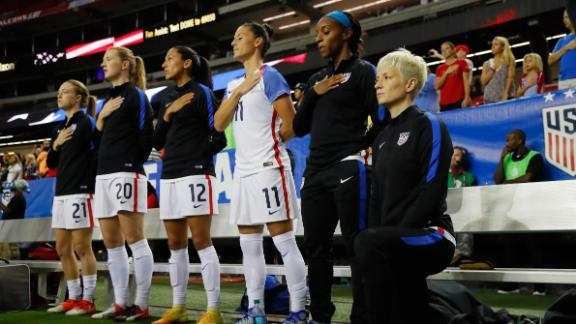 Rapinoe kneels during the US national anthem prior to the match between the United States and the Netherlands at Georgia Dome.