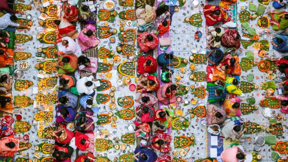Dhaka, Bangladesh: In Bangladesh, Hindu devotees sit together on a temple floor to observe Rakher Upobash celebrations.
