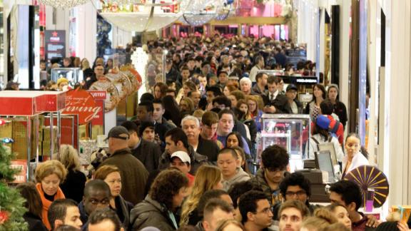 Shoppers crowd the aisles in Macys department store in Herald Square, New York, on November 26, 2015. Many retail outlets opened their doors to bargain hunters looking for Black Friday deals on Thanksgiving day, a day earlier than the traditional start to the sales season.  AFP PHOTO/TREVOR COLLENS / AFP / TREVOR COLLENS        (Photo credit should read TREVOR COLLENS/AFP/Getty Images)