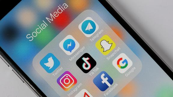PARIS, FRANCE - NOVEMBER 07:  In this photo illustration, the social medias applications logos, Twitter, Messenger, Telegram, Instagram, Tik Tok, Snapchat, Gmail, Facebook and Google are displayed on the screen of an Apple iPhone on November 07, 2018 in Paris, France. Tik Tok, also called Douyin is a Chinese mobile application for video sharing and social networking developed by the Toutiao company. The application TikTok, which allows to create video clips, becomes the most downloaded application in the world in number of downloads, in front of Facebook, Snapchat and Instagram. Downloaded almost 4 million times in the United States alone, today it has about 500 million active users each month worldwide.