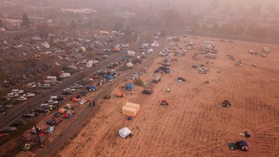 Evacuees from the Camp Fire shelter in tents outside the Walmart in Chico, California.