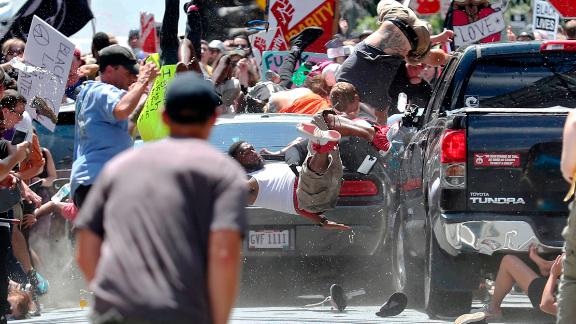 People fly into the air as Fields' car drives into a group of protesters in Charlottesville on August 12, 2017. The photo, taken by Ryan Kelly of The Daily Progress newspaper, won Kelly a Pulitzer Prize.