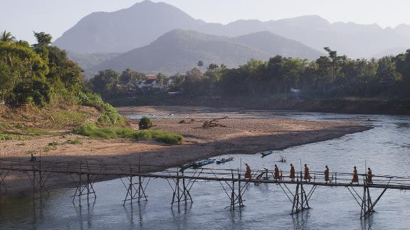 The Mekong is not just one river. Thousands of rivers and streams feed into the main river, including the Nam Khan tributary in Laos, pictured here. During the dry season, villagers build a bamboo bridge to cross the river.