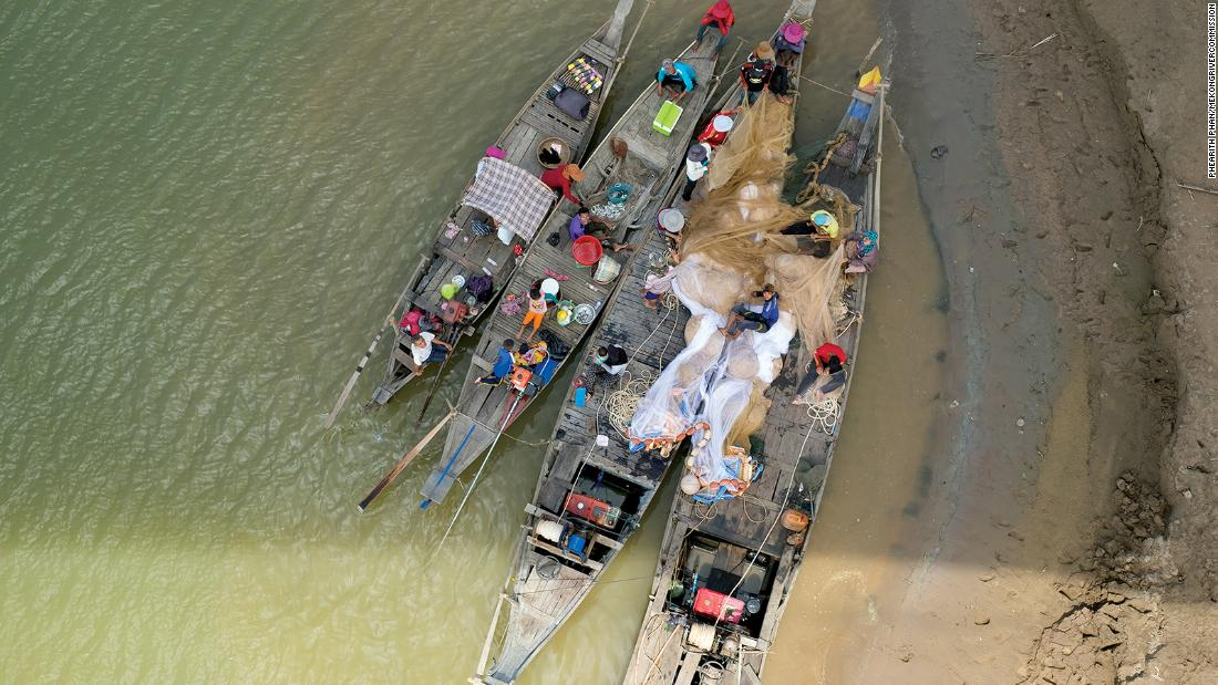 Some communities live in boats on the river, such as the Cham people pictured here on the western bank of the Mekong in Kampong Cham, Cambodia.