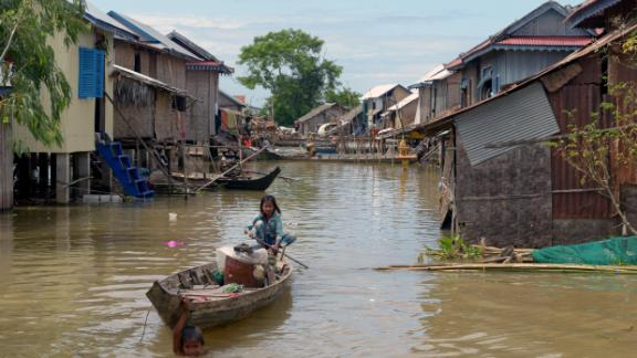 Communities living on the river are vulnerable to flooding, particularly during the monsoon season. In 2013, floods in Cambodia left more than 80 dead and wreaked havoc in villages like this one in Kandal province.