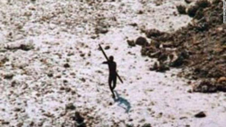 An image of a Sentinelese tribesman aiming a bow and arrow at a helicopter in 2004, following the Indian Ocean tsunami.