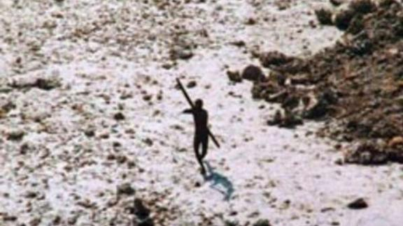 An image of a Sentinelese tribesman aiming a bow and arrow at a helicopter which was assessing the tribe's wellbeing in 2004, following the Indian Ocean tsunami.