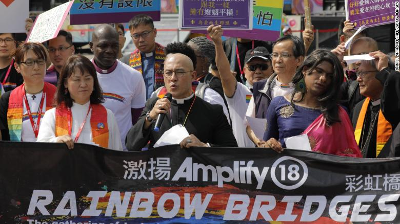 Members of a pro-gay Christian group assemble for the media before the start of a gay pride parade in Taipei on October 27, 2018.